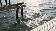 Small pier broken and destroyed by a heavy storm - second angle 4k Stock Footage