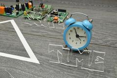 Project triangle - closeup on the time factor Stock Photos