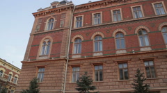 Chernivtsi regional state administration. Front view. Trees. Sun. - stock footage