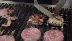 Making beef burgers with bacon and cheese Stock Footage