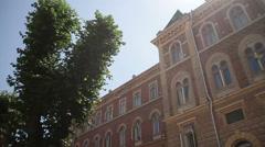 Chernivtsi regional state administration. Tree. Sun. Stock Footage