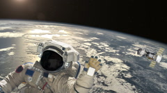 Astronaut and satellite above the Earth. Elements of this video furnished by NAS Stock Footage