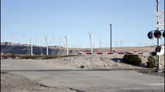 Train Crossing In The Desert And Glimpse Of Windmills  Stock Footage