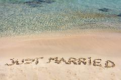 Just Married written in sand on a beautiful beach Stock Photos