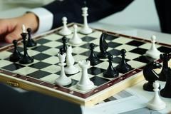 Figures on chessboard - stock photo