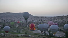 Balloons prepare for take-off before sunrise, Cappadocia Stock Footage