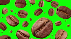 Coffee Beans falling down on green background Stock Footage