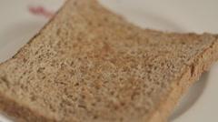 Rasperry jam  on toasted bread Stock Footage