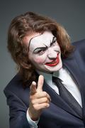 Wicked businessman - stock photo