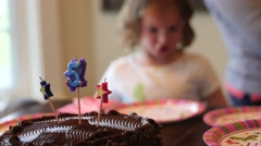Kids singing happy birthday around the cake Stock Footage