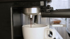Coffee machine Making Cappuccino in cup Stock Footage