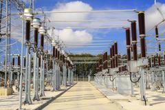 High voltage switchyard in electrical substation Stock Photos