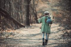 Little girl  in the forest photo Stock Photos