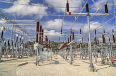 High voltage switchyard in electrical substation - stock photo