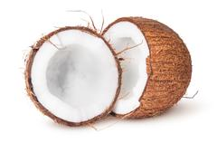 Two halves of coconut Stock Photos