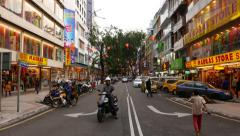 View on small colorful street, from the middle, motorbike drive aside Stock Footage