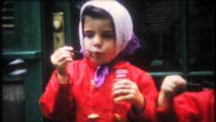 2172 - little girls blow bubbles - vintage film home movie Stock Footage