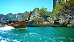 RAILAY BEACH, THAILAND - CIRCA FEB 2015: Handcrafted, wooden tour boat cruisi Stock Footage