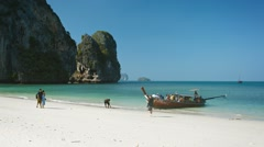 RAILAY BEACH, THAILAND - CIRCA FEB 2015: Happy tourists, strolling along the Stock Footage