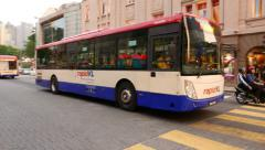 Rapid KL public bus parallax shot, around vehicle Stock Footage