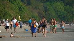 RAILAY BEACH, THAILAND - CIRCA FEB 2015: Happy tourists crowd the popular Rai Stock Footage