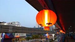 Chinese paper lantern close up against dusk city view monorail track Stock Footage
