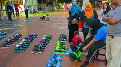 Stock Video Footage of KUALA LUMPUR, MALAYSIA - CIRCA FEB 2015: Family renting rollerblades for an a
