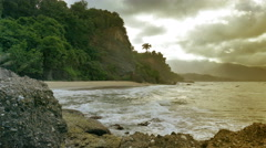 Foggy afternoon at a Caribbean coastline with waves hitting the rocks. Stock Footage