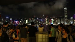 People watch music and laser (light) show represented on Hong Kong Island Stock Footage