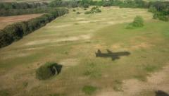 Stock Video Footage of 4K Aerial Airplane View Landing Plane in Airport Flying Aircraft Shade on Runway