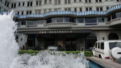 Peninsula Hotel Hong Kong, located in Tsim Sha Tsui, Kowloon, Hong Kong Stock Footage