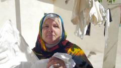 Berber woman hanging up family laundry Stock Footage