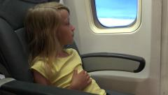 4K Young Girl Travelling Plane Pensive Thinking Tourist Child Aboard Airplane Stock Footage
