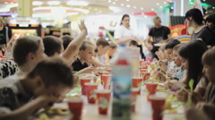 School-age children celebrating birthday in a cafe Stock Footage