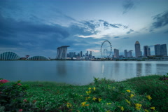 Unique wide angle 4k timelapse of Singapore skyline from day to night sunset - stock footage
