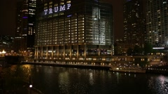 Trump Building On River in Chicago at night, Illinois, USA Stock Footage