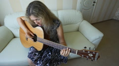 Girl with guitar at home Stock Footage