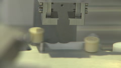 CU machinery caps on Syringes-2 Arkistovideo