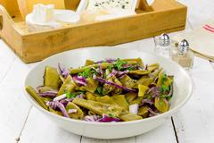 plate of fresh green beans and red onions - stock photo
