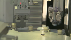 Close up of syringe filling machine Stock Footage