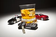Highway Patrol Police and Sports Car Next to Alcoholic Drink and Keys - stock photo
