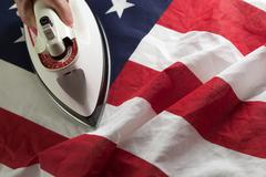 Ironing Out the Wrinkles in the American Flag Concept. Stock Photos