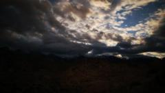 Astrophotography Time Lapse of Overcast Clearing up over Alpine Mountains - stock footage