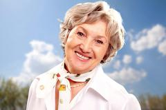 Grey-haired woman - stock photo