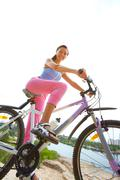 Woman cyclist - stock photo