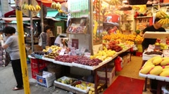 Sellers are laid out fresh fruit and vegetables on the storefront, Hong Kong Stock Footage