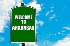 Green road sign with greeting message Welcome to ARKANSAS  - stock photo