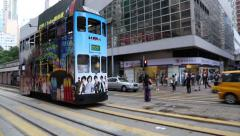 Old double-decker tram on the Wan Chai Road in Hong Kong Stock Footage