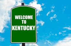 Green road sign with greeting message Welcome to KENTUCKY - stock photo