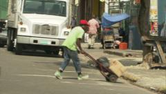 Porter in Kingston market in Jamaica (live audio) Stock Footage
